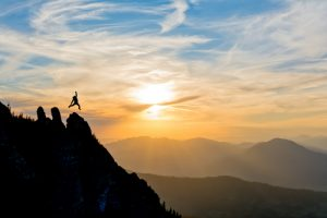 woman taking a leap to success
